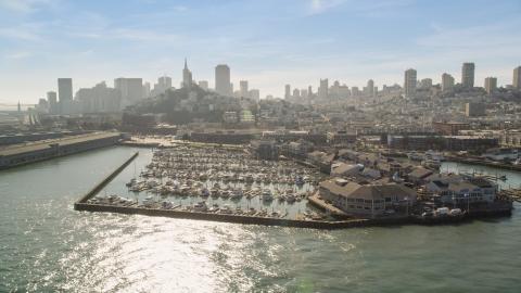 DCSF05_070.0000597 - Aerial stock photo of Pier 39 and marina, San Francisco skyline in background, San Francisco, California