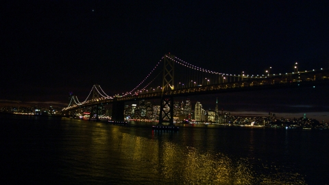 DCSF06_002.0000085 - Aerial stock photo of The Bay Bridge in front of the Downtown San Francisco skyline, California, night