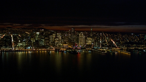 DCSF06_003.0000210 - Aerial stock photo of Downtown San Francisco skyscrapers seen from San Francisco Bay, California, night