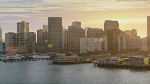DCSF07_015.0000091 - Aerial stock photo of The downtown skyline, seen from piers on the bay, Downtown San Francisco, California, sunset