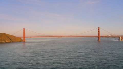 DCSF07_047.0000002 - Aerial stock photo of Wide view of the Golden Gate Bridge at sunset in San Francisco, California