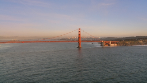 DCSF07_048.0000059 - Aerial stock photo of The Golden Gate Bridge with Downtown San Francisco skyline behind it, California, sunset
