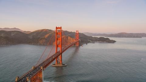DCSF07_052.0000301 - Aerial stock photo of Golden Gate Bridge, Marin Headlands in the background, San Francisco, California, sunset