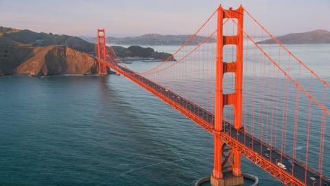 DCSF07_053.0000562 - Aerial stock photo of The Golden Gate Bridge, Marin Headlands behind it, San Francisco, California, sunset