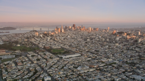 DCSF07_055.0000215 - Aerial stock photo of Marina District with Downtown San Francisco in the background, California, sunset