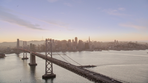 DCSF07_070.0000279 - Aerial stock photo of The Bay Bridge with a view of Downtown San Francisco skyline, California, twilight