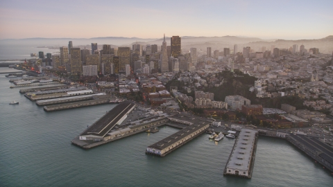 DCSF07_081.0000283 - Aerial stock photo of Piers by Coit Tower, and Downtown San Francisco skyscrapers, California, twilight