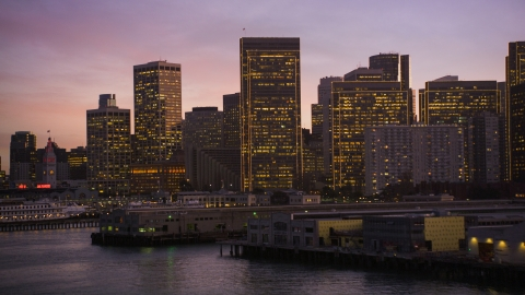 DCSF07_087.0000247 - Aerial stock photo of The skyline of Downtown San Francisco seen from piers on the shore, California, twilight