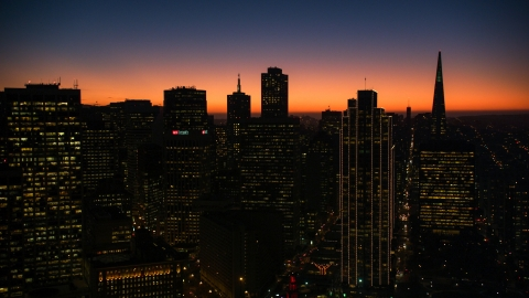 DCSF07_107.0000317 - Aerial stock photo of Twilight glow behind skyscrapers in Downtown San Francisco, California