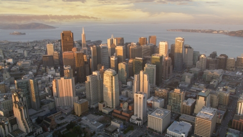DCSF10_003.0000001 - Aerial stock photo of The Downtown San Francisco cityscape and San Francisco Bay, California, sunset