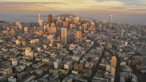 DCSF10_004.0000140 - Aerial stock photo of Skyscrapers in Downtown San Francisco, San Francisco Bay in the background, California at sunset