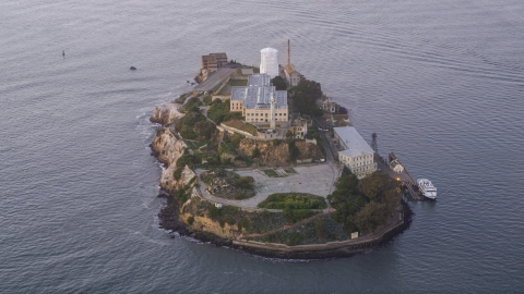 DCSF10_022.0000192 - Aerial stock photo of Alcatraz Island prison at sunset in San Francisco, California