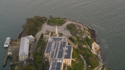 DCSF10_024.0000245 - Aerial stock photo of The Alcatraz lighthouse and main building, San Francisco, California, sunset