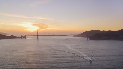 DCSF10_025.0000033 - Aerial stock photo of Setting sun behind the Golden Gate Bridge, San Francisco, California, sunset