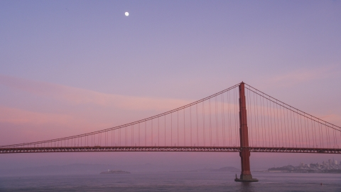 DCSF10_030.0000481 - Aerial stock photo of The moon above the Golden Gate Bridge at twilight in San Francisco, California