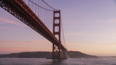 DCSF10_035.0000000 - Aerial stock photo of A Golden Gate Bridge tower in San Francisco, California, twilight