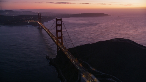DCSF10_050.0000000 - Aerial stock photo of Heavy traffic crossing the Golden Gate Bridge, San Francisco, California, twilight