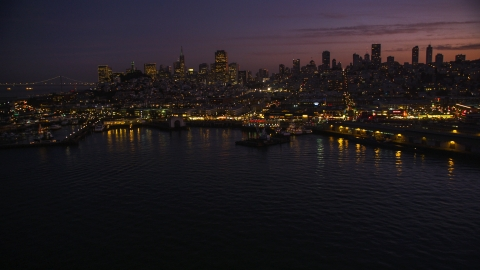 DCSF10_055.0000451 - Aerial stock photo of Fisherman's Wharf, with downtown skyline in the background, San Francisco, California, twilight