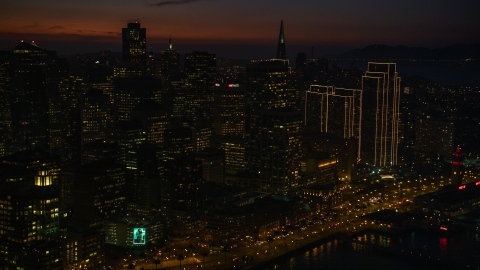 DCSF10_070.0000023 - Aerial stock photo of Tall downtown skyscrapers in Downtown San Francisco, California, night