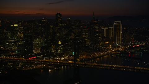 DCSF10_071.0000539 - Aerial stock photo of Heavy traffic on the Bay Bridge by Downtown San Francisco skyscrapers, California, night