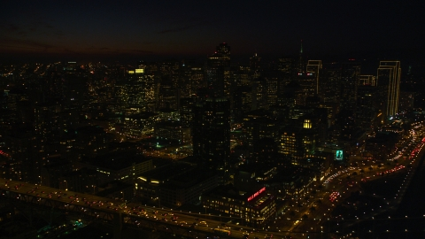 DCSF10_081.0000155 - Aerial stock photo of Downtown San Francisco skyscrapers seen from the Bay Bridge, California, night