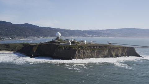 DFKSF15_068.0000271 - Aerial stock photo of The Pillar Point Air Force Station beside the ocean in Half Moon Bay, California