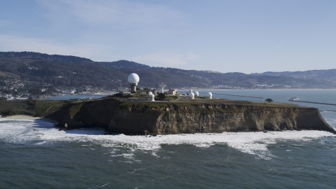 DFKSF15_068.0000333 - Aerial stock photo of The Pillar Point Air Force Station near coastal hills in Half Moon Bay, California