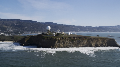 DFKSF15_068.0000345 - Aerial stock photo of Pillar Point Air Force Station by steep cliffs in Half Moon Bay, California