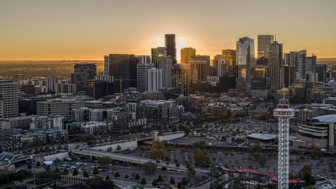 DXP001_000092 - Aerial stock photo of Sunrise behind the city's skyline in Downtown Denver, Colorado