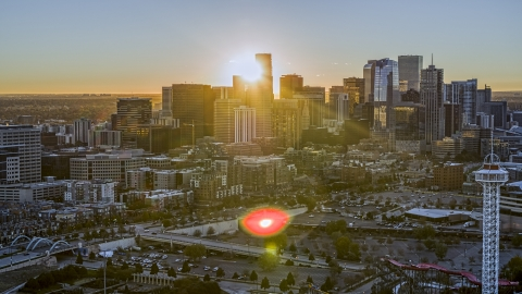 DXP001_000093 - Aerial stock photo of Sunrise behind the city's skyline in Downtown Denver, Colorado