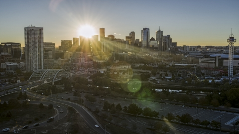 DXP001_000103 - Aerial stock photo of The city skyline with the sun behind the skyscrapers at sunrise in Downtown Denver, Colorado