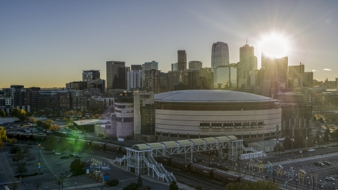 DXP001_000114 - Aerial stock photo of Pepsi Center arena with the city's skyline in the background at sunrise, Downtown Denver, Colorado