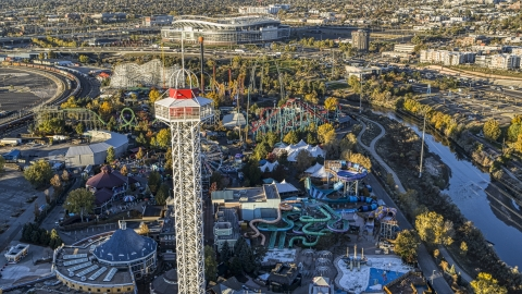DXP001_000117 - Aerial stock photo of Theme park rides and roller coasters at Elitch Gardens at sunrise, Downtown Denver, Colorado