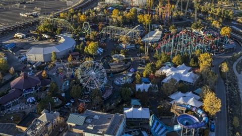 DXP001_000118 - Aerial stock photo of Theme park rides, Ferris wheel and roller coasters at Elitch Gardens at sunrise, Downtown Denver, Colorado