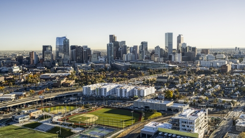 DXP001_000120 - Aerial stock photo of City skyline in the background behind apartment buildings and sports fields, Downtown Denver, Colorado