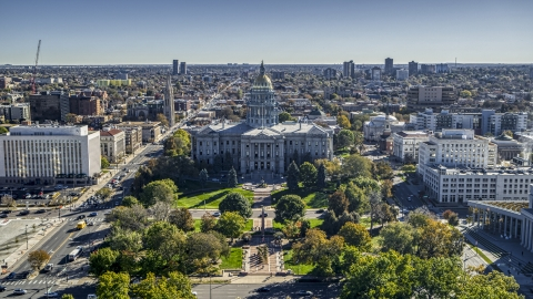 DXP001_000144 - Aerial stock photo of The Colorado State Capitol building viewed from Civic Center Park in Downtown Denver, Colorado