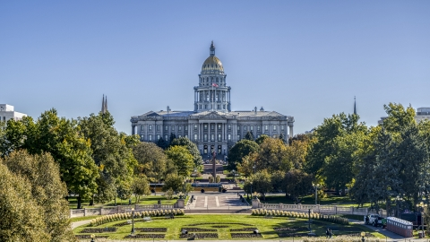 DXP001_000152 - Aerial stock photo of Colorado State Capitol seen from park lined with trees in Downtown Denver, Colorado