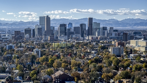 DXP001_000163 - Aerial stock photo of The city's skyline with mountains in the background, Downtown Denver, Colorado