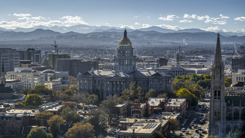 DXP001_000165 - Aerial stock photo of The Colorado State Capitol building with mountains in the background, Downtown Denver, Colorado