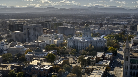 DXP001_000176 - Aerial stock photo of The Colorado State Capitol and nearby buildings, mountains in background, Downtown Denver, Colorado