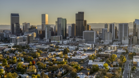 DXP001_000181 - Aerial stock photo of City's skyline seen from tree-lined neighborhood at sunset, Downtown Denver, Colorado