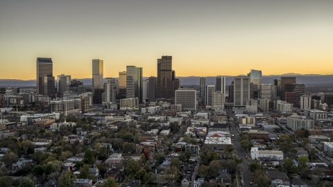 DXP001_000183 - Aerial stock photo of Wide view of the city's downtown skyline at sunset, Downtown Denver, Colorado