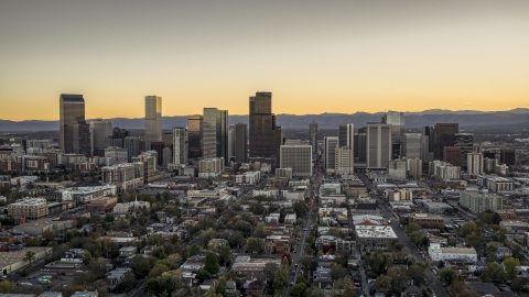 DXP001_000185 - Aerial stock photo of Wide view of skyscrapers in the city's downtown skyline at sunset, mountains in background, Downtown Denver, Colorado