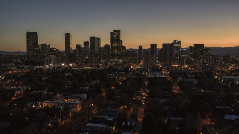 DXP001_000191 - Aerial stock photo of Giant skyscrapers in the city's skyline at twilight, Downtown Denver, Colorado