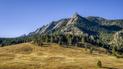 DXP001_000194 - Aerial stock photo of Green Mountain and flatirons behind a tree-topped hill, Rocky Mountains, Colorado