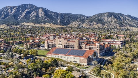DXP001_000204 - Aerial stock photo of Buildings at the University of Colorado Boulder campus and mountains in the background, Boulder, Colorado