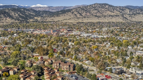 DXP001_000206 - Aerial stock photo of The small town near mountain ridges, Boulder, Colorado
