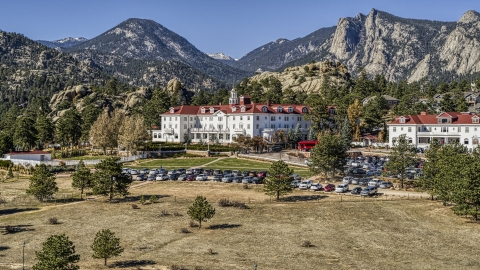 DXP001_000207 - Aerial stock photo of The historic Stanley Hotel with mountains in the background in Estes Park, Colorado