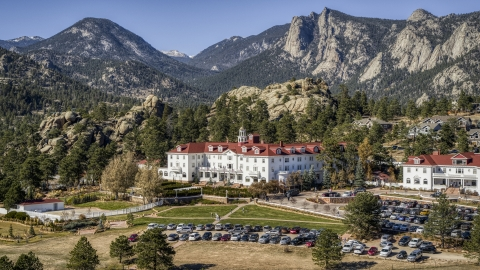 DXP001_000211 - Aerial stock photo of The historic Stanley Hotel, and mountains in the background in Estes Park, Colorado