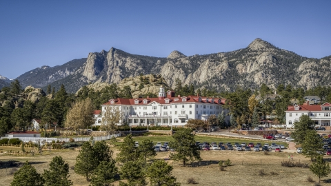 DXP001_000213 - Aerial stock photo of The famous Stanley Hotel, with mountains behind it in Estes Park, Colorado